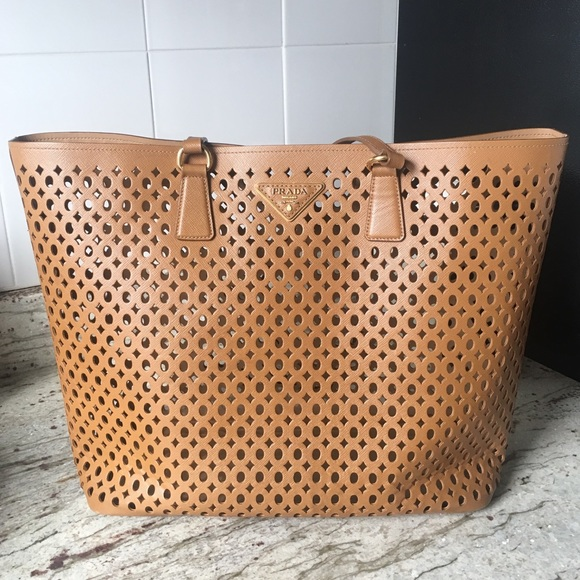 4d4a1a466fd8 Prada Bags   Perforated Saffiano Leather Tote Bag   Poshmark